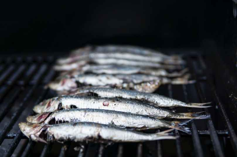 photo of raw fish on grill